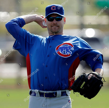 Kerry Wood Chicago Cubs pitcher Kerry Wood throws during a spring training baseball workout, in Mesa, Ariz