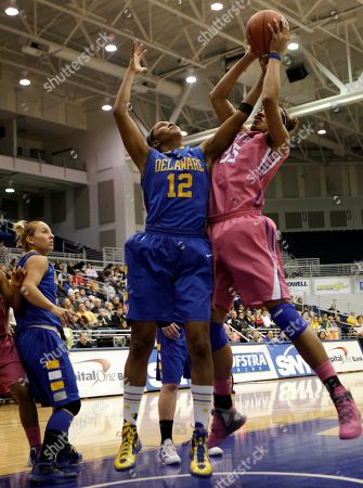 Danielle Parker, Marie Malone Delaware forward Danielle Parker (12) defends as Hofstra center Marie Malone (35) goes up for a shot in the second half of their NCAA college basketball game in Hempstead, N.Y