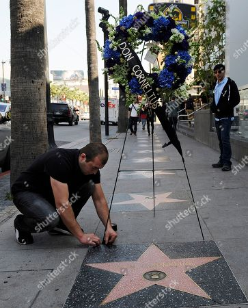 """Arthur Manoukian Arthur Manoukian, left, of Tic-Tock Couture Florals lays down a wreath on behalf of the Hollywood Historic Trust at the star for """"Soul Train"""" creator Don Cornelius on the Hollywood Walk of Fame in Los Angeles, . Cornelius died of an apparent self-inflicted gunshot wound at his home in Los Angeles this morning"""