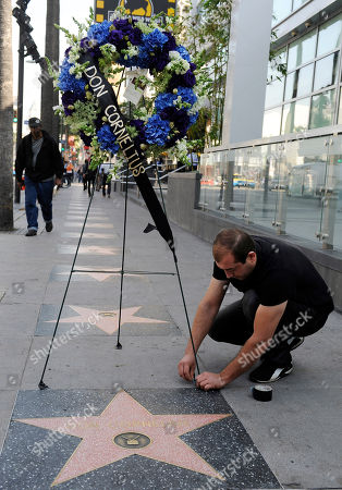 """Arthur Manoukian Arthur Manoukian of Tic-Tock Couture Florals lays down a wreath on behalf of the Hollywood Historic Trust at the star for """"Soul Train"""" creator Don Cornelius on the Hollywood Walk of Fame in Los Angeles, . Cornelius died of an apparent self-inflicted gunshot wound at his home in Los Angeles this morning"""