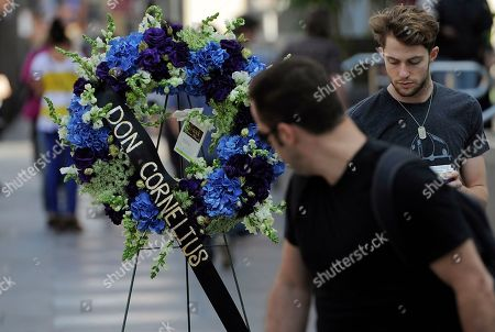 """Pedestrians on Hollywood Boulevard walk past a wreath laid down on behalf of the Hollywood Historic Trust at the star for """"Soul Train"""" creator Don Cornelius on the Hollywood Walk of Fame in Los Angeles, . Cornelius died of an apparent self-inflicted gunshot wound at his home in Los Angeles this morning"""