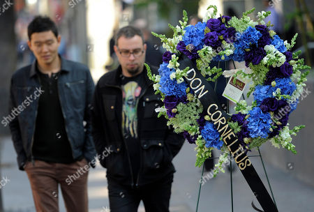"""Pedestrians walk past a wreath laid down on behalf of the Hollywood Historic Trust on the star for """"Soul Train"""" creator Don Cornelius on the Hollywood Walk of Fame in Los Angeles, . Cornelius died of an apparent self-inflicted gunshot wound at his home in Los Angeles this morning"""