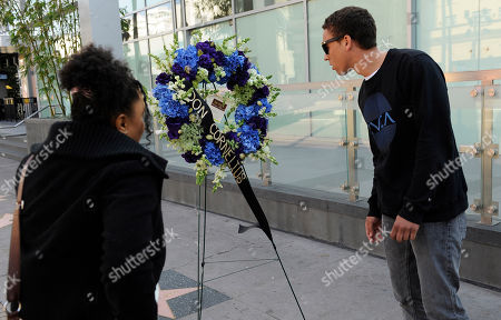 """Janel Thomas, Taylor Bourne Janel Thomas, left, of Los Angeles, and Taylor Bourne of Huntington Beach, Calif., look at a wreath laid down on the star for """"Soul Train"""" creator Don Cornelius on the Hollywood Walk of Fame in Los Angeles, . Cornelius died of an apparent self-inflicted gunshot wound at his home in Los Angeles this morning"""