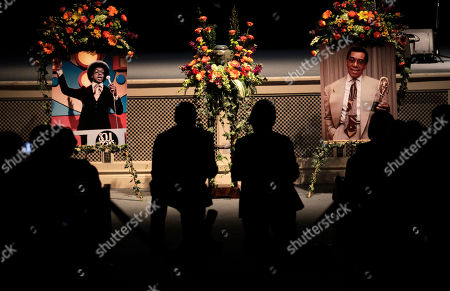 """Two photos of """"Soul Train"""" creator and host Don Cornelius are displayed during a private memorial service for Cornelius in Los Angeles, . Cornelius died Feb. 1 from a self-inflicted gunshot wound. Since then, tributes to him and the show he created have been held around the country"""