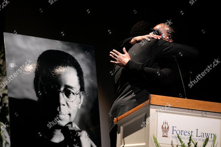 """Stock Photo of Tony Cornelius and his brother Raymond, right, sons of """"Soul Train"""" creator and host Don Cornelius, hug after reading a statement during a private memorial service for Cornelius in Los Angeles, . Cornelius died Feb. 1 from a self-inflicted gunshot wound. Since then, tributes to him and the show he created have been held around the country"""