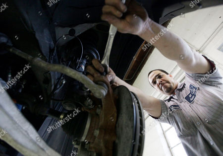 Stock Image of Javier Soto Javier Soto works on a brake assembly at M&A Auto Body shop in Chicago. U.S. service companies expanded in February at the fastest pace in a year, as new orders rose and employment increased