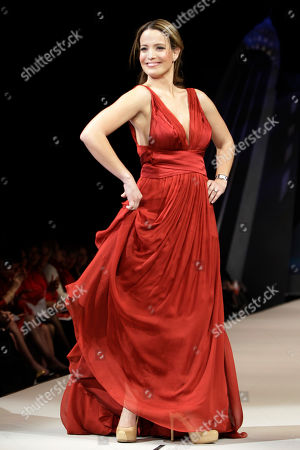 Jeannette Torres Alvarez Jeannette Torres-Alvarez models Carlos Miele during the Heart Truth Red Dress fashion show in New York