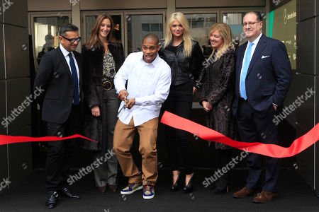 Victor Cruz, Naeem Kahn, Stephanie Winston-Wolkoff, Lisa Holladay, Peter Levy, Kate Upton Victor Cruz, second from left, is joined by designer Naeem Kahn, left, Fashion at Lincoln Center director Stephanie Winston-Wolkoff, second from left, model Kate Upton, third from right, Mercedes-Benz Manager Lisa Holladay, second from right, and IMG Fashion Managing Director Peter Levy as he cuts the ribbon kicking off the Fall 2012 season at Mercedes-Benz Fashion Week, in New York