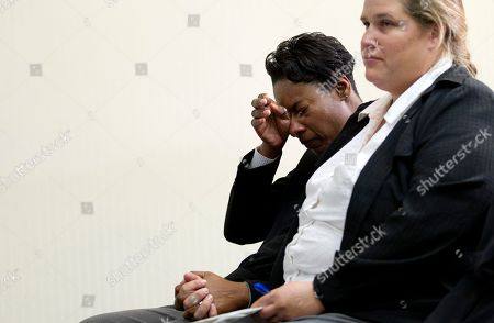 Tracey Cooper-Harris, Maggie Cooper-Harris Tracey Cooper-Harris, who served in the Army for 12 years, left, wipes her eyes as she sits with her spouse Maggie Cooper-Harris after speaking at a news conference at the National Press Club in Washington, . Tracey Cooper-Harris is suing the federal government because she and her wife are being denied military benefits granted to heterosexual couples