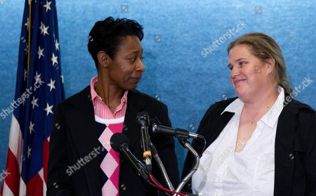 Tracey Cooper-Harris, Maggie Cooper-Harris Tracey Cooper-Harris, who served in the Army for 12 years, left, and her spouse, Maggie Cooper-Harris speak during a news conference at the National Press Club in Washington, . Tracey Cooper-Harris is suing the federal government because she and her wife are being denied military benefits granted to heterosexual couples