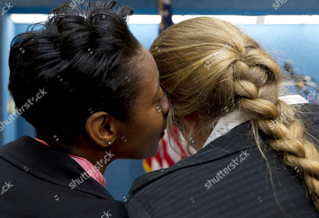 Tracey Cooper-Harris, Maggie Cooper-Harris Tracey Cooper-Harris, who served in the Army for 12 years, left, whispers to her spouse, Maggie Cooper-Harris during a news conference at the National Press Club in Washington, . Tracey Cooper-Harris is suing the federal government because she and her wife are being denied military benefits granted to heterosexual couples