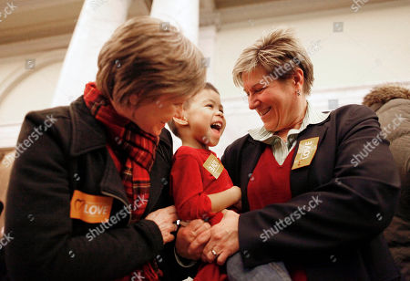 Amy Lewis, Tricia Benson, Will Lewis-Benson Amy Lewis, left, and Tricia Benson celebrate with their son, Will Lewis-Benson, 3, in the Maryland State House after the House of Delegates passed a gay marriage bill in Annapolis, Md