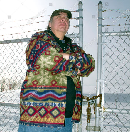 Larry Thompson Larry Thompson stands on his family's land at Raquette Point on the Mohawks' Akwesasne Reservation in northern New York, next to the chain-link fence that separates it from the former General Motors landfill, in Massena, N.Y., on . Residents of the Akwesasne reservation are not satisfied with Superfund cleanup plans that would leave the PCB-contaminated landfill in place, capped