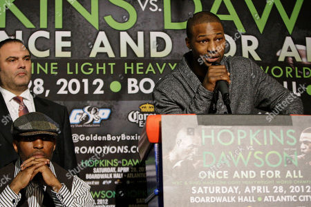 Bernard Hopkins, Chad Dawson Bernard Hopkins, left, and Richard Schaefer of Golden Boy Productions, above left, listen as Chad Dawson, right, speaks during a news conference to promote an upcoming fight in New York. Hopkins and Dawson will fight for Hopkins WBC light heavyweight title on Saturday, April, 28, 2012 in Atlantic City, N.J