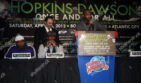 Bernard Hopkins, Chad Dawson Boxer Chad Dawson speaks as Bernard Hopkins, seated second from left, Richard Schaefer of Golden Boy Promotions, standing behind Hopkins, and Naazim Richardson, left, listen during a news conference to promote an upcoming fight in New York. Hopkins and Dawson will fight for Hopkins WBC light heavyweight title on Saturday, April, 28, 2012 in Atlantic City, N.J
