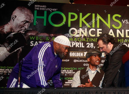 Bernard Hopkins Boxers Bernard Hopkins, center, speaks with Richard Schaefer of Golden Boy Productions, right, and trainer Naazim Richardson, left, after a news conference to promote an upcoming fight with Chad Dawson in New York. Hopkins and Dawson will fight for Hopkins WBC light heavyweight title on Saturday, April, 28, 2012 in Atlantic City, N.J