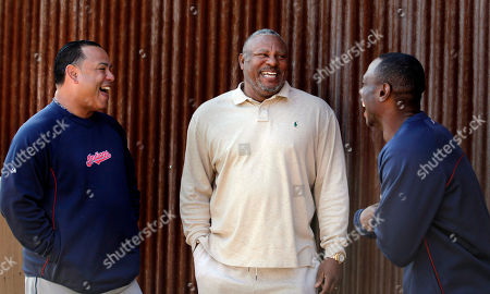 Albert Belle, Kenny Lofton, Carlos Baerga Former baseball player Albert Belle, center, shares a laugh with former Cleveland Indians teammates Carlos Baerga, left, and Kenny Lofton as Belle visits the Indians' spring training camp in Goodyear, Ariz