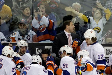 Doug Weight New York Islanders interim coach Doug Weight talks with players during a timeout in the third period of an NHL hockey game against the Buffalo Sabres in Buffalo, N.Y., . Doug Weight filled in as the New York Islanders interim coach for their game for Jack Capuano who is sick with the flu. The Sabres won 2-1