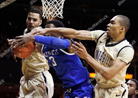 Terrence Jones, Jeffery Taylor, Lance Goulbourne Kentucky forward Terrence Jones (3) fights for a rebound with Vanderbilt's Jeffery Taylor, left, and Lance Goulbourne, right, in the second half of an NCAA college basketball game, in Nashville, Tenn. Kentucky won 69-63