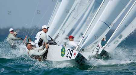 Richard Clark, Tyler Bjorn Vasyl Gureyev and Volodymyr Korotkov, front, from Ukraine, race in the Star series at the Miami Olympic Classes Regatta on Biscayne Bay in Miami, . More than 500 sailors from 44 countries are competing in the stepping stone to the Olympic games