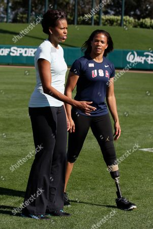 Michelle Obama, April Holmes First lady Michelle Obama walks with paralympian April Holmes as she participates is a physical activity with kids at the ESPN Wide World of Sports Complex at the Walt Disney World Resort, in Orlando, Fla., during her three day national tour celebrating the second anniversary of Let's Move