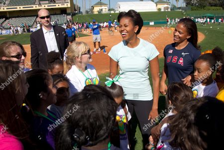 Michelle Obama, April Holmes First lady Michelle Obama laughs after playing with kids at the ESPN Wide World of Sports Complex at the Walt Disney World Resort, in Orlando, Fla., during her three day national tour celebrating the second anniversary of Let's Move. Standing behind is paralympian April Holmes