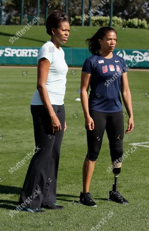 Michelle Obama, April Holmes First lady Michelle Obama talks with paralympian April Holmes as she participates is a physical activity with kids at the ESPN Wide World of Sports Complex at the Walt Disney World Resort, in Orlando, Fla., during her three day national tour celebrating the second anniversary of Let's Move