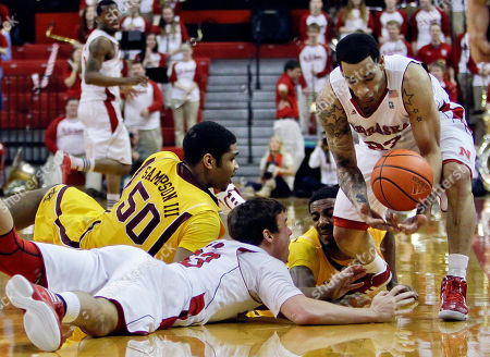 Mike Fox, Mike Fox, Austin Hollins, Ralph Sampson III Minnesota's Ralph Sampson III (50) and Austin Hollins, rear, scramble for a loose ball against Nebraska's Mike Fox, front, and Bo Spencer, right, in the first half of their NCAA college basketball game in Lincoln, Neb