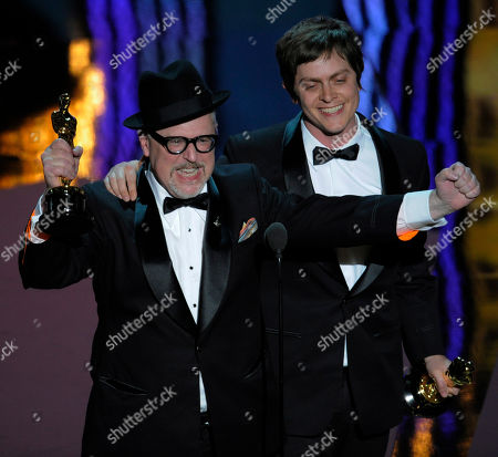 """William Joyce and Brandon Oldenburg accept the Oscar for best-animated short film for """"The Fantastic Flying Books of Mr. Morris Lessmore"""" during the 84th Academy Awards in the Hollywood section of Los Angeles. When Joyce saw the restored Fritz Lang silent movie """"Metropolis"""" and wanted to make something like it for children. That story, called """"The Numberlys,"""" has him in the running for his second Oscar in two years"""