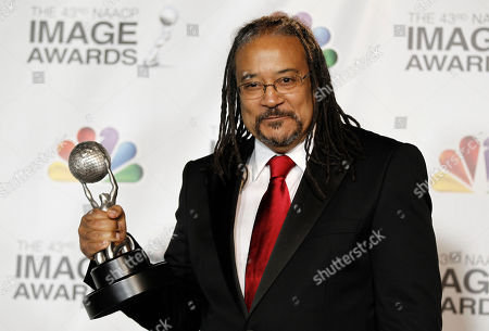 """Ernest Dickerson Ernest Dickerson is seen backstage with his award for outstanding directing in a dramatic series for """"Treme"""" at the 43rd NAACP Image Awards, in Los Angeles"""