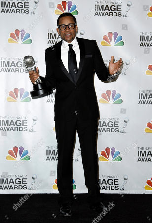 """Stock Image of Hill Harper Hill Harper poses backstage with the award for outstanding actor in a drama series for """"CSI: NY"""" at the 43rd NAACP Image Awards, in Los Angeles"""