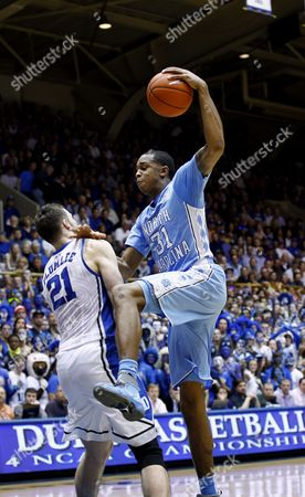 John Henson, Miles Plumlee North Carolina's John Henson (31) drives to the basket against Duke's Miles Plumlee (21) during the first half of an NCAA college basketball game in Durham, N.C