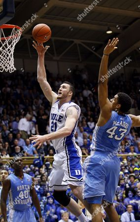 James Michael McAdoo, Miles Plumlee Duke's Miles Plumlee (21) shoots as North Carolina's James Michael McAdoo (43) defends during the second half of an NCAA college basketball game in Durham, N.C., . North Carolina won 88-70
