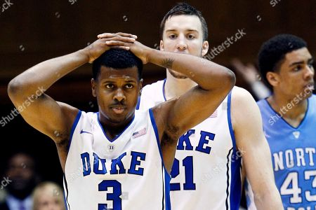 Tyler Thornton, Miles Plumlee, James Michael McAdoo Duke's Tyler Thornton (3) and Miles Plumlee react towards the end of an NCAA college basketball game against North Carolina in Durham, N.C., . North Carolina won 88-70. At rear is North Carolina's James Michael McAdoo (43
