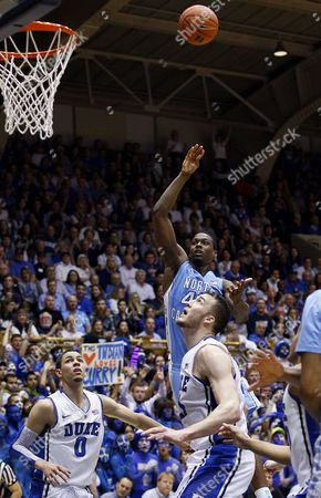 Harrison Barnes, Austin Rivers, Miles Plumlee Duke's Austin Rivers (0) and Miles Plumlee watch while North Carolina's Harrison Barnes shoots during the first half of an NCAA college basketball game in Durham, N.C
