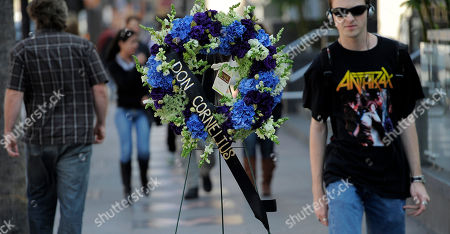 """Pedestrians on Hollywood Blvd. walk past a wreath laid down on behalf of the Hollywood Historic Trust on the star for """"Soul Train"""" creator Don Cornelius on the Hollywood Walk of Fame in Los Angeles, . Cornelius died of an apparent self-inflicted gunshot wound at his home in Los Angeles this morning"""