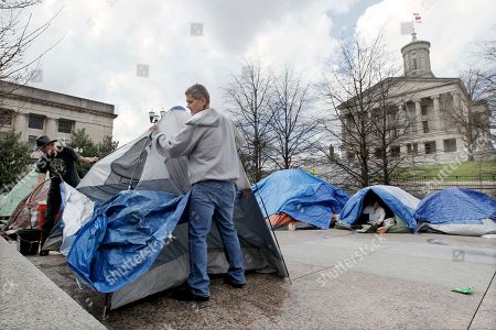 Frank Williams, Tom Sweet Occupy Nashville protesters Frank Williams, right, and Tom Sweet, left, set a tent back up that was blown over by the wind, in Nashville, Tenn. Gov. Bill Haslam signed a bill Friday aimed at evicting Occupy Nashville protesters. Officials said the eviction will be enforced after seven days