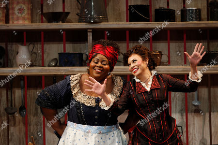 """Angela Renee Simpson, Alyson Cambridge Angela Renee Simpson, left, portraying, Queenie, and Alyson Cambridge, portraying Julie Laverne, perform at a dress rehearsal during the first act of the Lyric Opera of Chicago's production of """"Show Boat"""