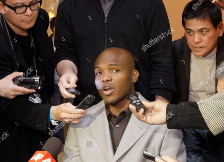 Timothy Bradley Jr. talks with reporters at a news conference to promote his upcoming welterweight championship boxing match against Manny Pacquiao, in Beverly Hills, Calif. The pair will meet at the MGM Grand Garden in Las Vegas on June 9