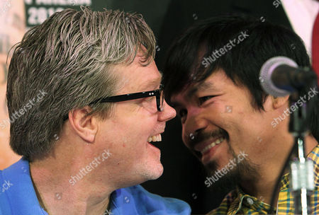 Manny Pacquiao, Freddie Roach Manny Pacquiao, right, of the Philippines, talks with his trainer Freddie Roach during a news conference to promote his upcoming welterweight championship boxing match against Timothy Bradley Jr. not shown, in Beverly Hills, Calif., . The pair is scheduled to meet at the MGM Grand Garden in Las Vegas on June 9