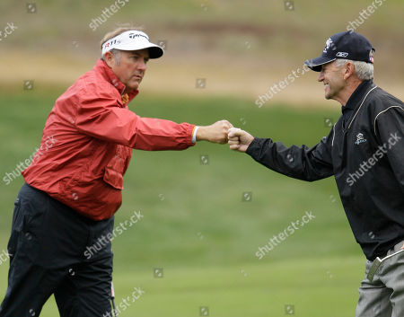 Ken Duke, Tom Dreesen Ken Duke, left, greets amateur partner and comedian Tom Dreesen, right, after Dreesen made a birdie putt on the third green of the Monterey Peninusla Country Club shore course during the third round of the AT&T Pebble Beach National Pro-Am golf tournament in Pebble Beach, Calif