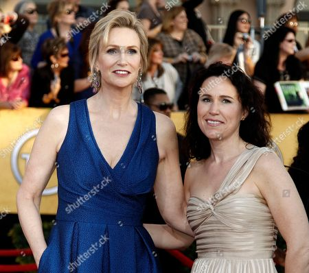Stock Picture of Jane Lynch, Lara Embry Jane Lynch, left, and Dr. Lara Embry arrive at the 18th Annual Screen Actors Guild Awards in Los Angeles. A Los Angeles judge finalized Lynch's divorce from Embry, more than four years after the pair were married in Massachusetts