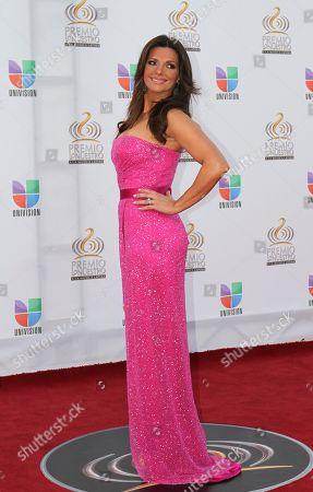 Barbara Bermudo Barbara Bermudo, host of Univision's Primer Impacto, poses for photographers at the red carpet at the Premio Lo Nuestro Music Awards in Miami