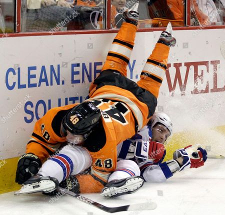 Danny Briere, Steve Eminger Philadelphia Flyers' Danny Briere, top, and New York Rangers' Steve Eminger collide in the second period of an NHL hockey game, in Philadelphia