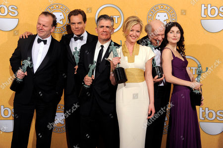 "Robert Clohessy, Michael Shannon, Gretchen Mol, Jacqueline Pennewill, Kevin O'Rourke, Peter Van Wagner From left, Robert Clohessy, Michael Shannon, Kevin O'Rourke, Gretchen Mol, Peter Van Wagner and Jacqueline Pennewill pose backstage with their awards for outstanding performance by an ensemble in a drama series for ""Boardwalk Empire"" at the 18th Annual Screen Actors Guild Awards on in Los Angeles"