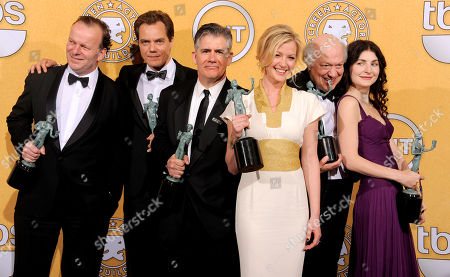 "Robert Clohessy, Michael Shannon, Kevin O'Rourke, Gretchen Mol, Peter Van Wagner, Jacqueline Pennewill From left, Robert Clohessy, Michael Shannon, Kevin O'Rourke, Gretchen Mol, Peter Van Wagner and Jacqueline Pennewill pose backstage with their awards for outstanding performance by an ensemble in a drama series for ""Boardwalk Empire"" at the 18th Annual Screen Actors Guild Awards on in Los Angeles"