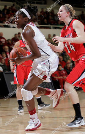 Ashley Ward, Chiney Ogwumike Stanford forward Chiney Ogwumike (13) drives in front of Seattle forward Ashley Ward (14) in the first half of an NCAA college basketball game in Stanford, Calif