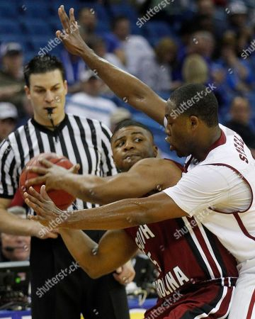 Andrew Steele, Eric Smith Alabama guard Andrew Steele, right, guards South Carolina guard Eric Smith (5) during the second half of an NCAA college basketball game in the first round of the Southeastern Conference basketball tournament at the New Orleans Arena in New Orleans