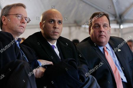 Eric Schmidt, Cory A. Booker, Chris Christie Google Executive Chairman and former CEO Eric Schmidt, left, sits with Newark Mayor Cory A. Booker and New Jersey Gov. Chris Christie, right, at the groundbreaking ceremonies for the Teachers Village development in downtown Newark, N.J. The mixed-use complex will feature new schools and housing for teachers with aim to help revitalize the downtown of New Jersey's largest city and draw new teachers to its struggling schools