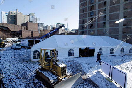 A tent sits on a large lot in downtown Newark, N.J., before groundbreaking ceremonies for a mixed-use development project, designed by renowned architect and Newark native, Richard Meier, that will contain several schools, a retail corridor and affordable teacher housing aimed at attracting new faces to the city's struggling schools